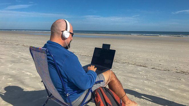 Make Money While Traveling - Digital Nomad on the beach