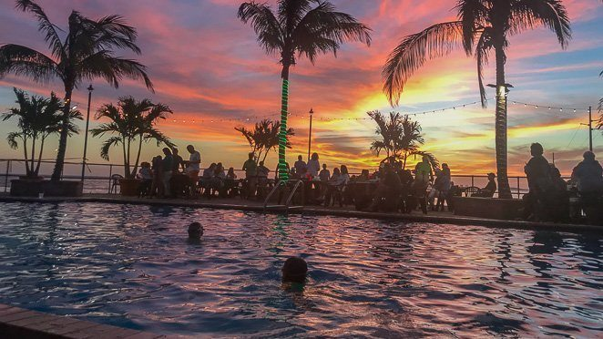 Watch the sunset at Sunset Grille in the pool