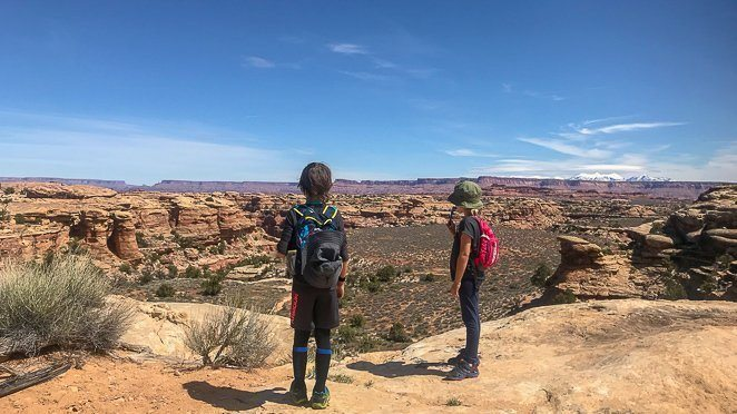 Visiting Utah National Parks with Kids - hiking with kids at Canyonlands_