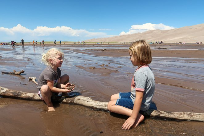 Play in the water at Great Sand Dunes
