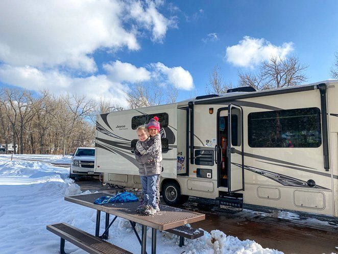 Wear gloves while living in a camper in the winter to stay warm